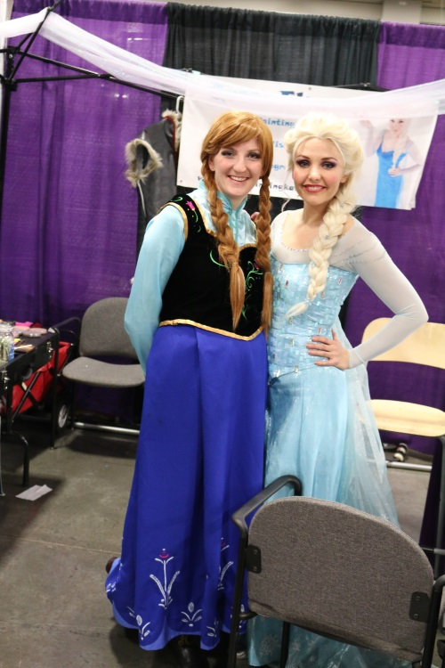 Elsa and Anna running a princess party booth.